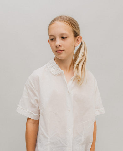 Girl wearing a white button up blouse