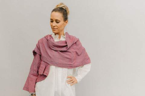 Woman in sunset wrap made of  raspberry pink cotton volie