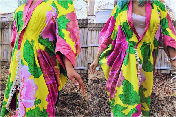 Details of waist tucks on the 503 Poirot Cocoon Coat made of bright yellow and pink African Wax Print.