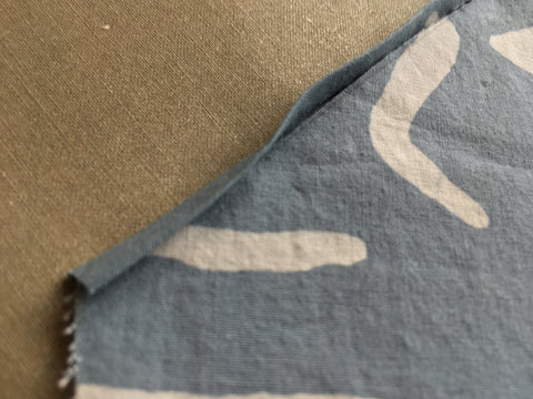 photo up close of raw edge sandiched in bias tape fold