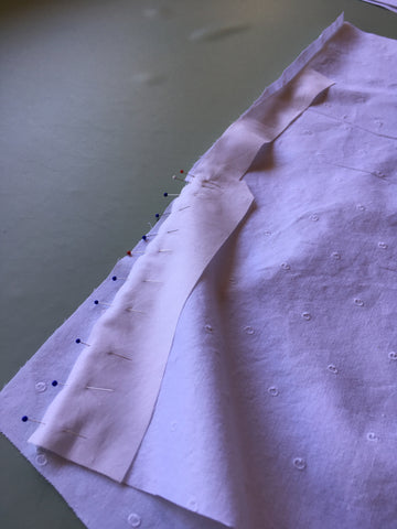 Wide section of lacket pinned to garment