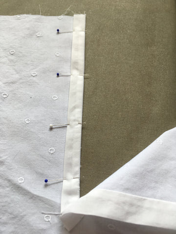 Narrow section of placket pinned to right side of garment.