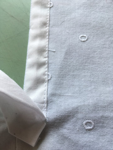 Narrow side of placket top-stitched in place.