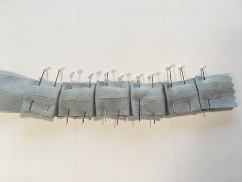 Back or underneath view of box-pleat ruching.