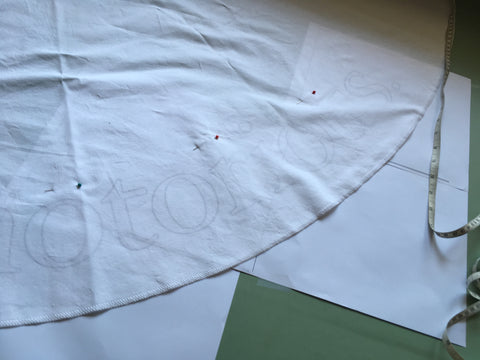 Photo of quote seen through the fabric to trace.
