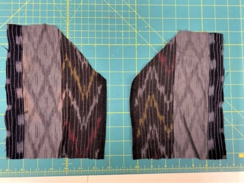 patch pockets cut from fabric lying on a green cutting mat