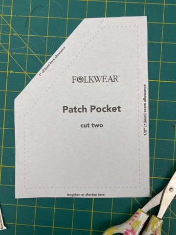patch pocket paper pattern laying on a cutting mat with scissors