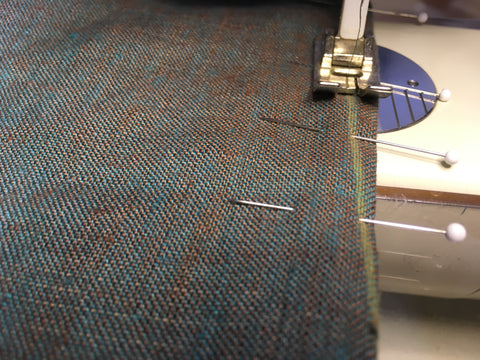 Sewing up the double-ended dart on the sewing machine.