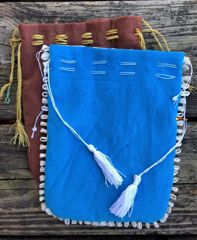 Blue and Brown Turkish drawstring bags laying on wooden deck