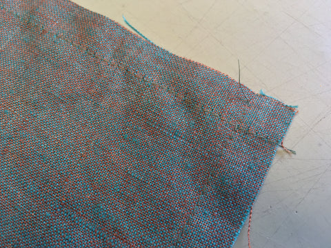 Baste stitch sewn as guide for turning edge