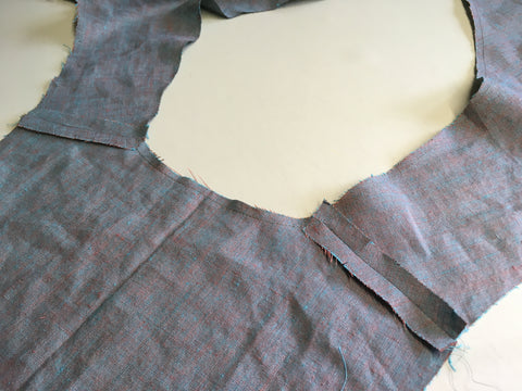 Shoulder seams sewn and pressed open