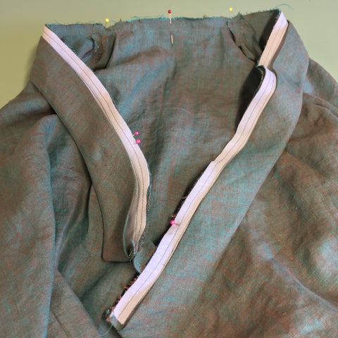 Neckband pined at shoulders, center back, and notches