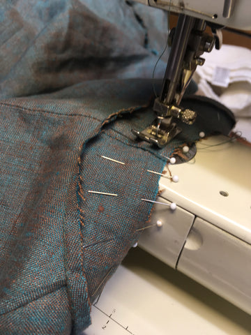 Stitching th armhole and facing on the sewing machine.