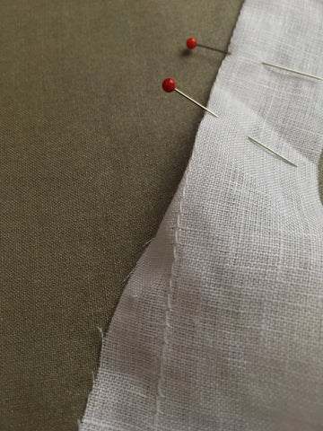 Photo using stitch and guide for turning under edge on the facing of Folkwear 210 Armistice Blouse