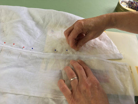 Photo showing pinning of Vestee to Folkwear 210 Blouse front using a book to help with pinning.