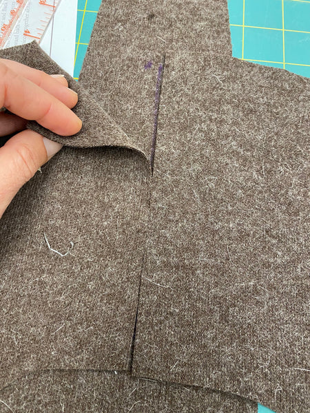 brown fabric pieces lined up to sew the pocket