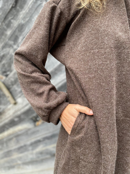 close up of pocket on brown dress