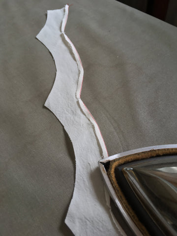 Photo of Folkwear 216 Schoolmistress Shirtwaist right side facing edges being turned and pressed