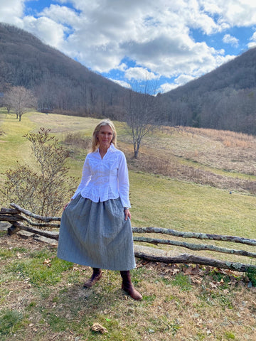 Photo of Molly in Folkwear 206 Quilted Prairie Skirt w Mnt background