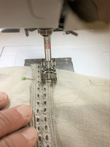 sewing insertion lace down on fabric
