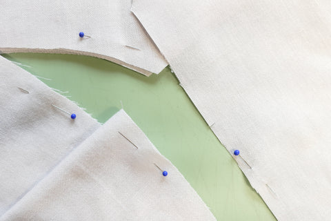 Right sides of Middy Blouse View A fabric marked using pins inside the seam allowance.
