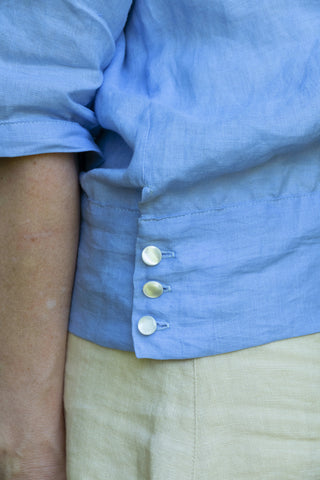 Detailed View Of Buttons on hip band of Middy Blouse View B.