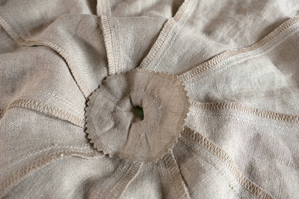 View of pinked linen circle sewn to the parasol canopy.