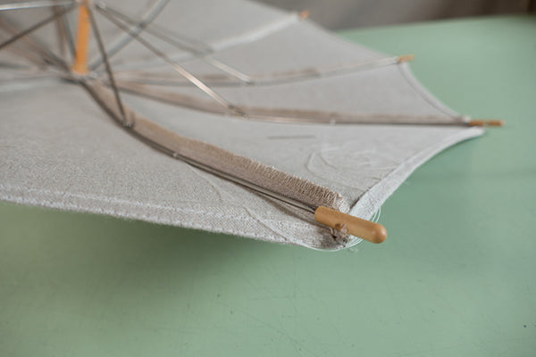 Photo of inside of parasol with tacks.