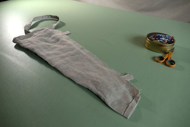 Carrier with strap inside and sewing up the seam