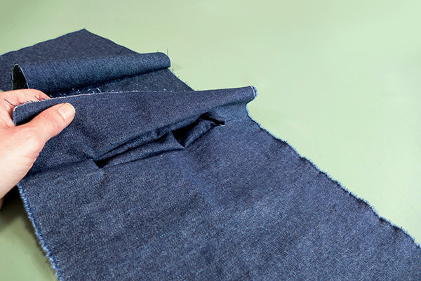 View of pocket pulled through slit to underneath side