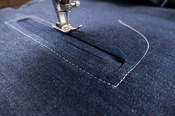 Top stitching around the pocket opening creates a nice detail and secures the welts in place.