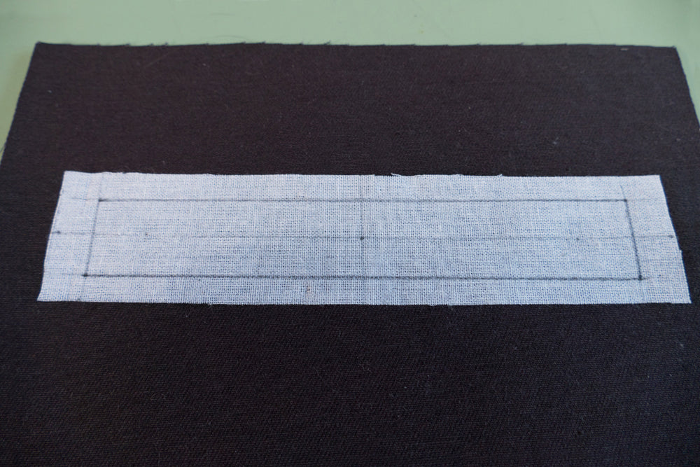 The rectangular pocket opening guide drawn on the fusible interfacing.