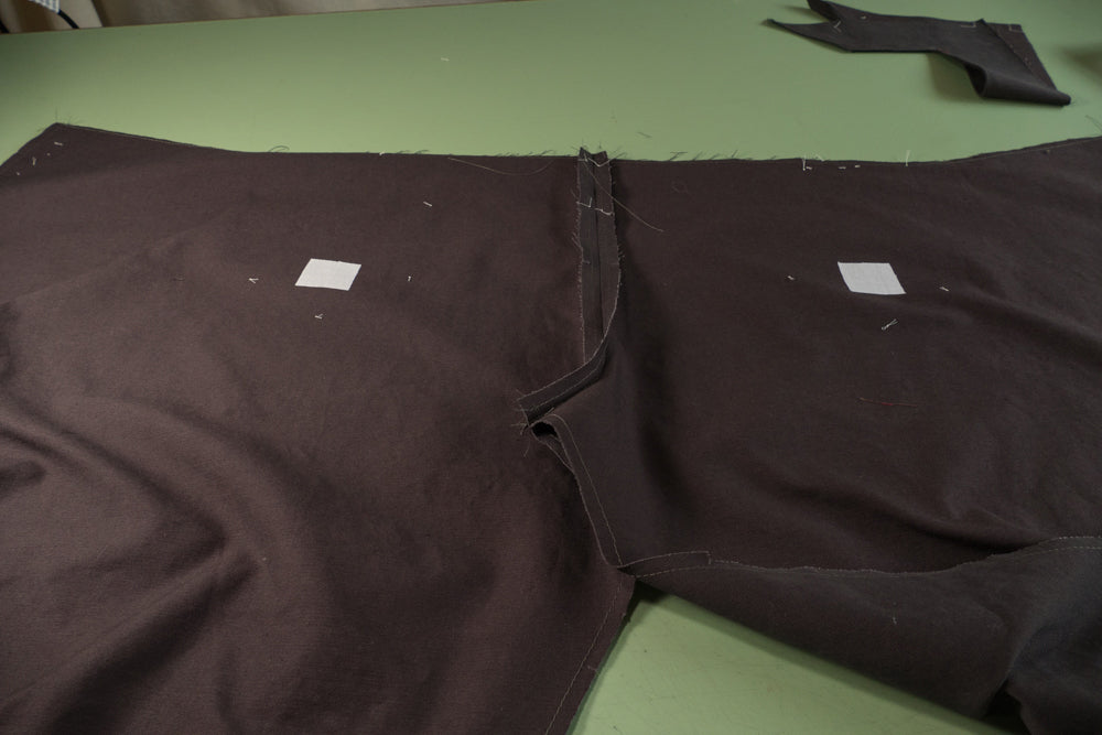 Fusible interfacing ironed to the wrong side of the pants at the slash lines.