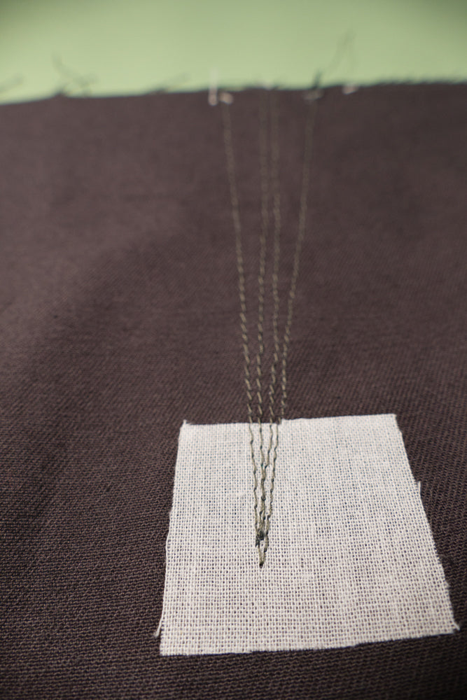 Stay stitch line inside the stitch line and on either side of the slash line onthe wrong side.