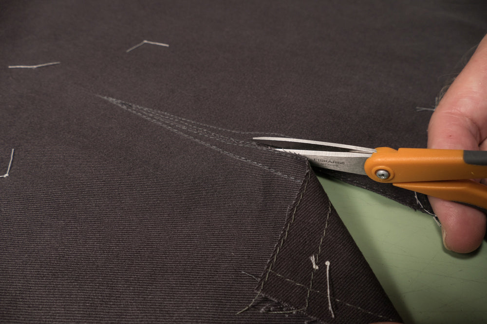 Use the guide line drawn on the front of the pant to start cutting the slash line.