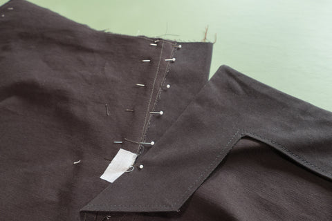 The Front Dart Gusset Facing aligned and pinned to the pants. The Front Buttonhole facing is laying flat.