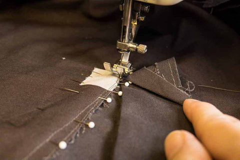 Starting sewing from the bottom dot and sewing up, using the stitch line as a guide. Back stitching at both ends.