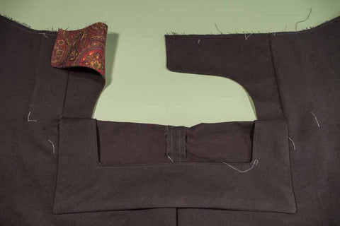 Front of the pant showing the Front Buttonhole Facing folded down revealing the Front Dart Gusset Facing.