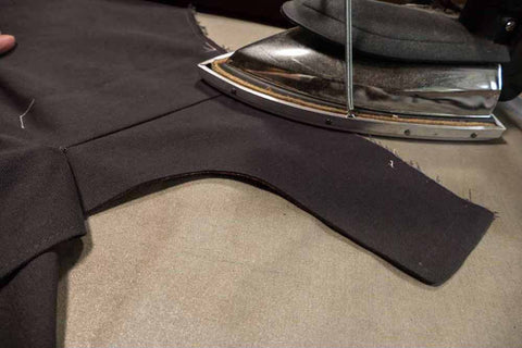 The right side of the pant up, with the Front Dart Gusset facing in place and the seam being pressed.