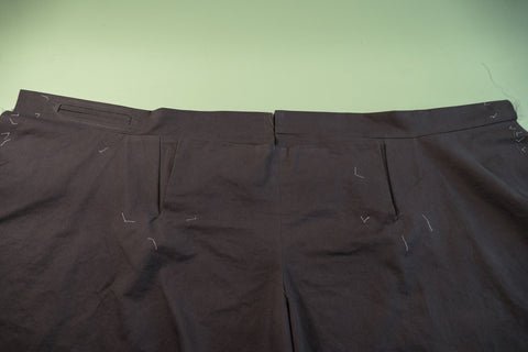 The outside of the pant with the Front Buttonhole Facing folded up.