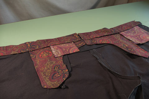 The inside of the pant with the waistband curtain folded down hiding the seam allowances.