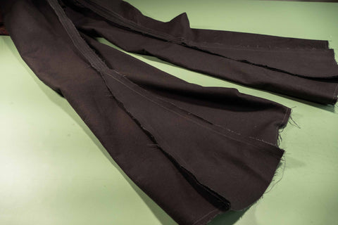 A view of the godets sewn in place as seen on the wrong side of the pants.
