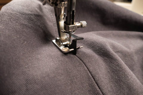 Stitching to the right of the center of the front crotch.