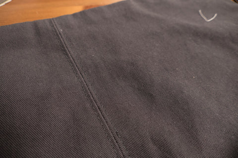 Topstitching on either side of the front crotch seam.
