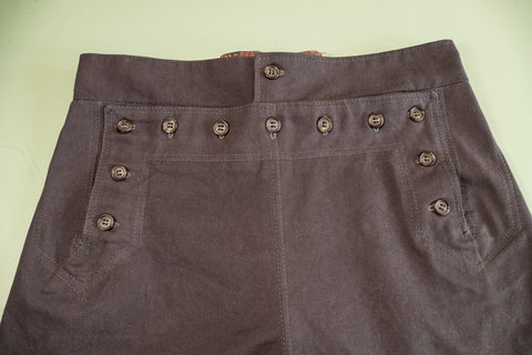 All the buttons sewn in place on the front of the pants.
