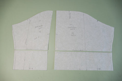 The front and back sleeve pattern pieces graded and cut.