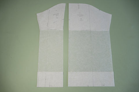 The sleeve pattern pieces separated to create a new longer sleeve pattern.