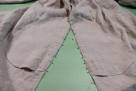 Pinning the pocket pieces into the side seams to the skirt side seams.