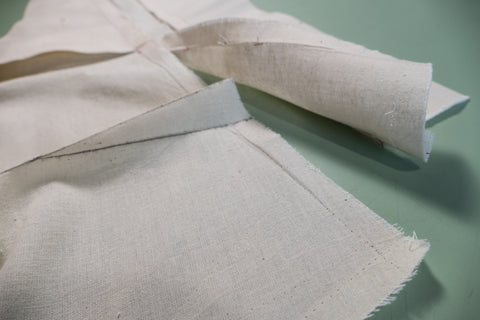 The dart folded in half takes up the excess fabric.