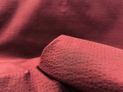 clay red colored cotton seersucker shirting fabric